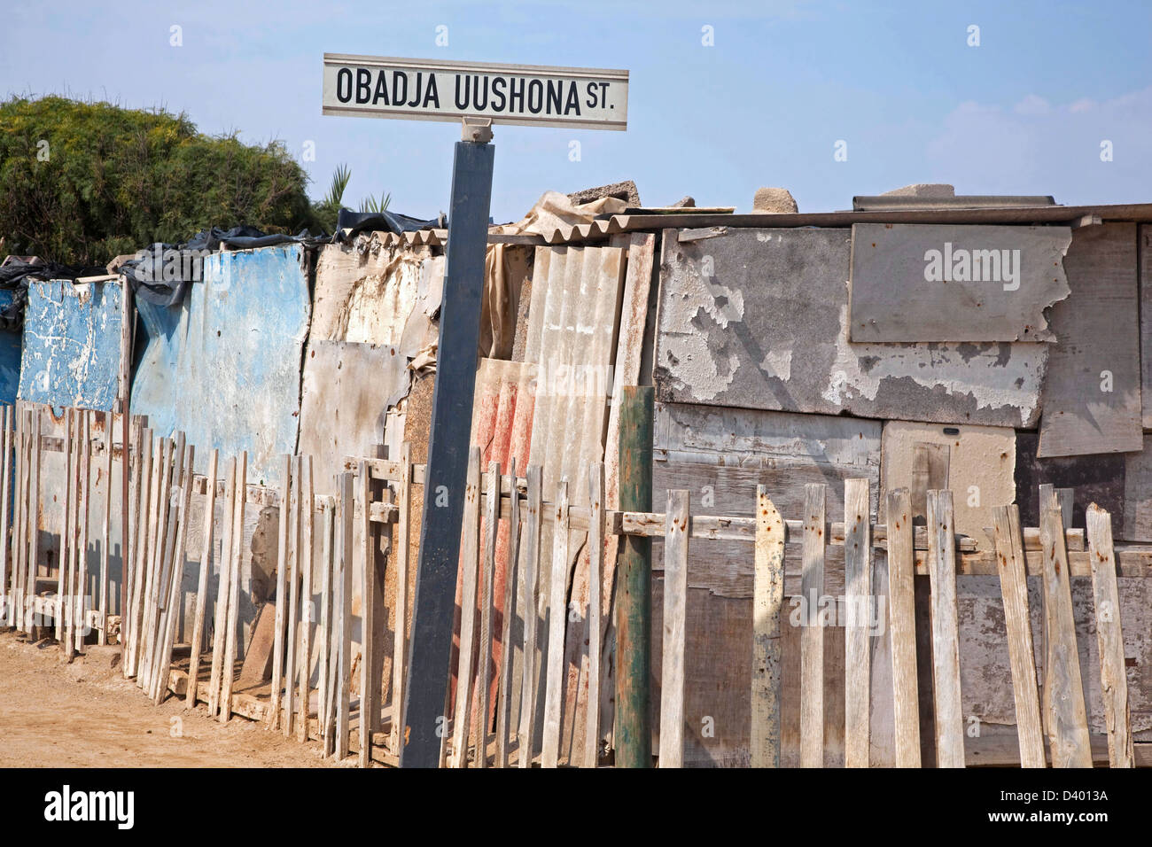 Street with improvised shacks, made from scrap materials at slum near Swakopmund, Namibia, South Africa - Stock Image