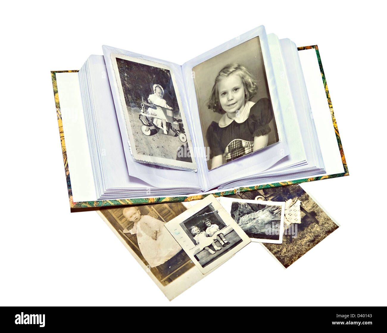 A photo album with old pictures of family members. - Stock Image