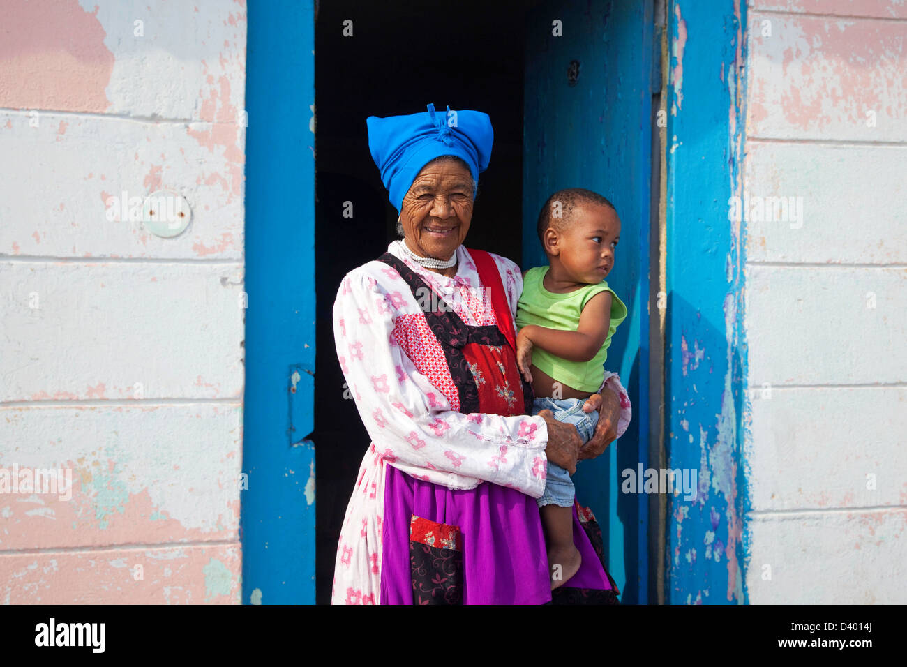 Grandmother with child in front of her house in township near Swakopmund, Namibia, South Africa - Stock Image