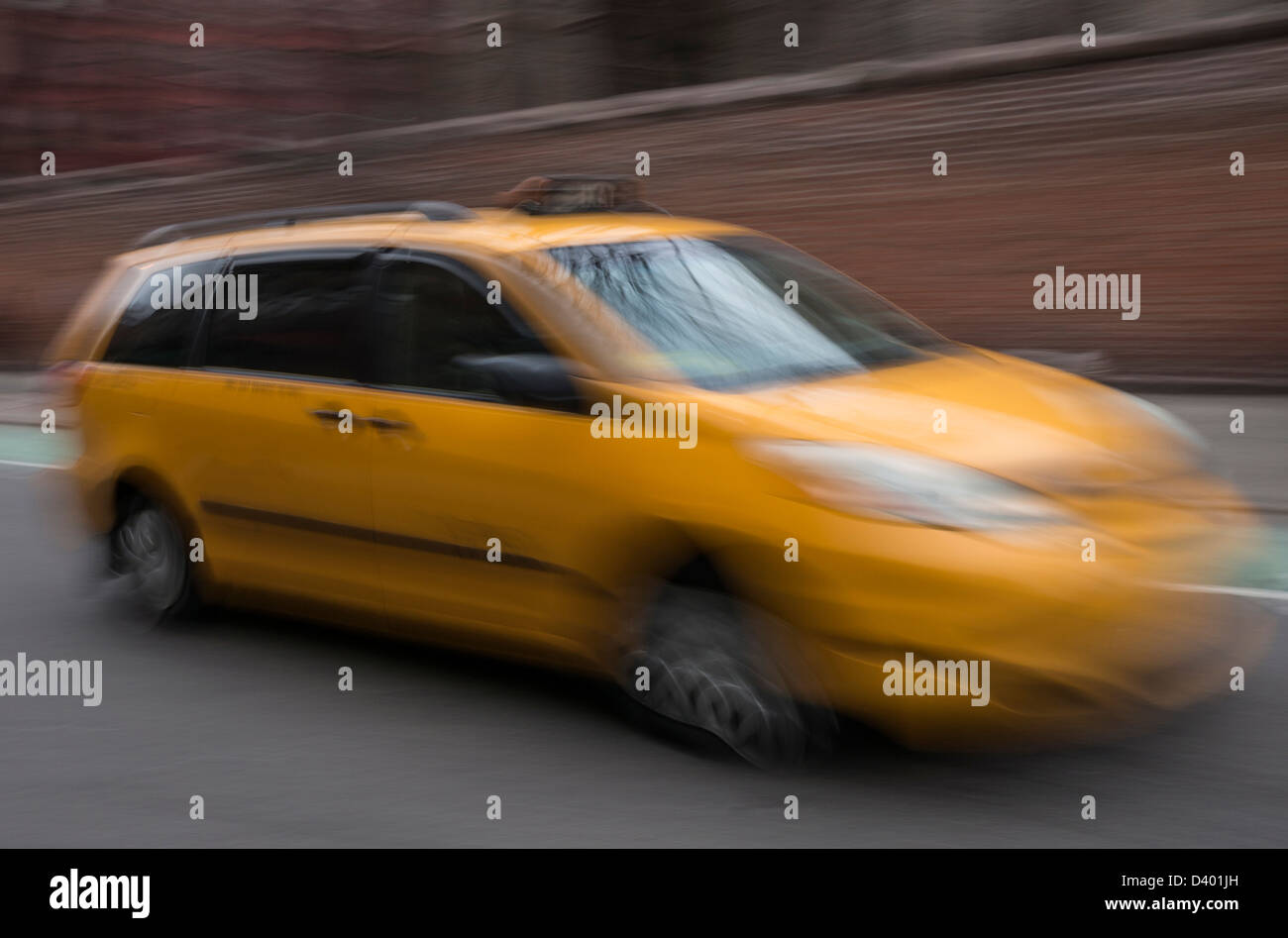A medallion hybrid yellow taxi cab in New York City Stock Photo
