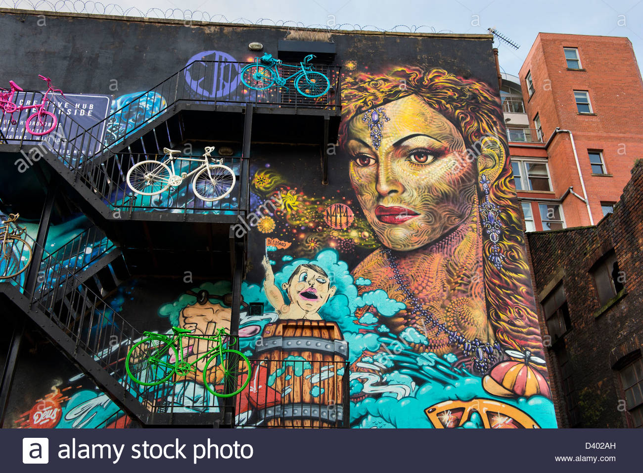 Painted gable wall with bicycles attached at Church Street / Red Lion Street, Manchester City Centre, UK - Stock Image