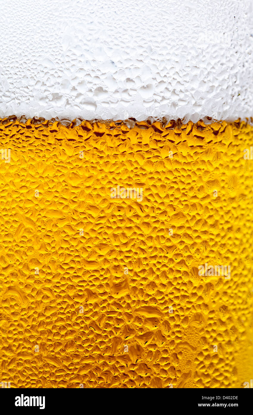 Close-up of condensation drops on a glass of cold lager - Stock Image