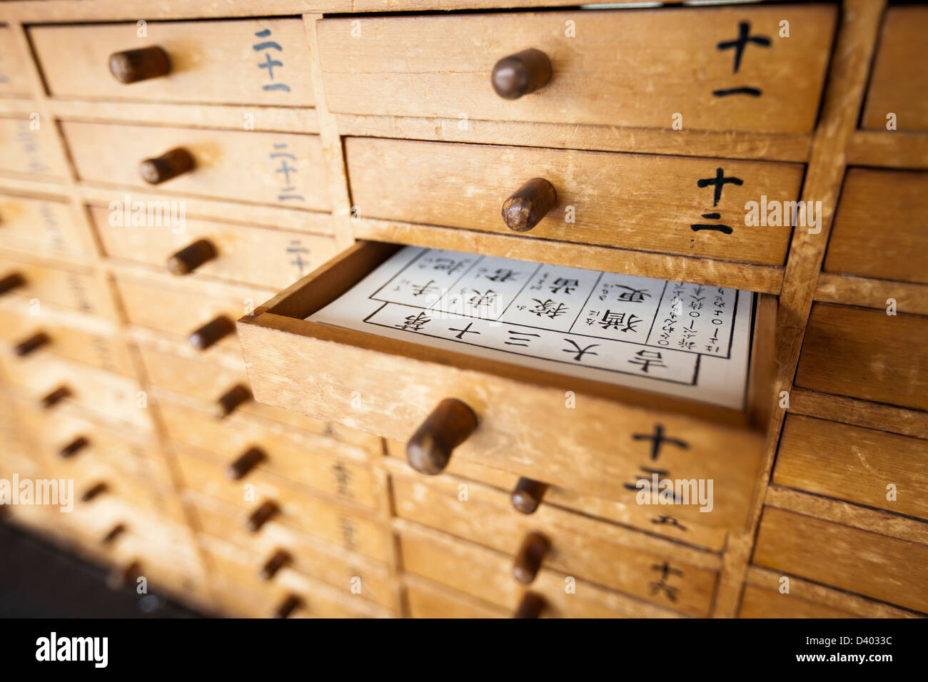 Omikuji drawers at a temple in Japan. - Stock Image
