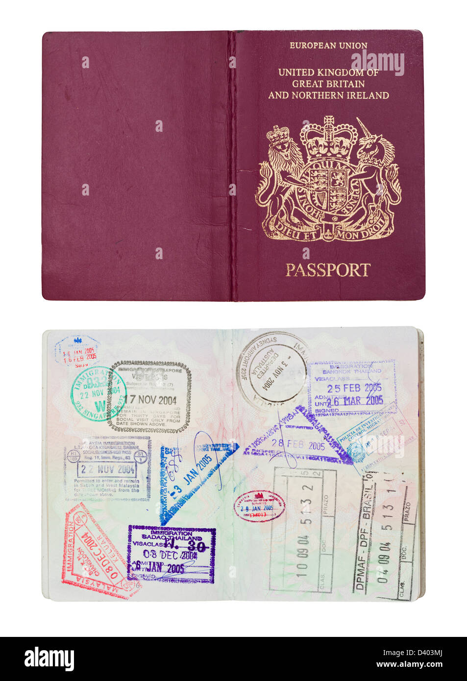 Inside and outside of a well travelled UK Passport, isolated against white with clipping path. - Stock Image