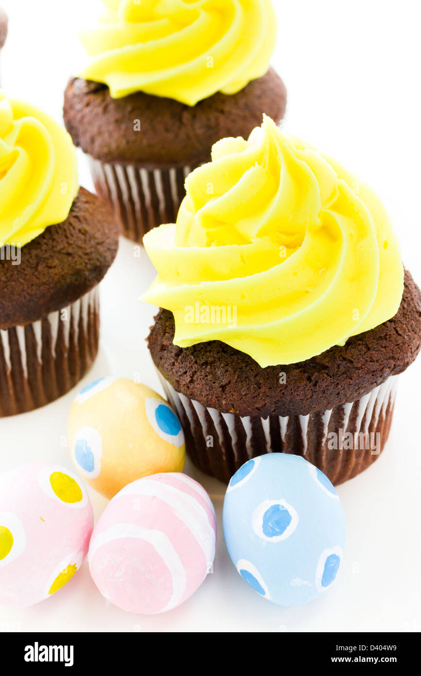 Gourmet cupcakes with yellow icing prepared for Easter. Stock Photo
