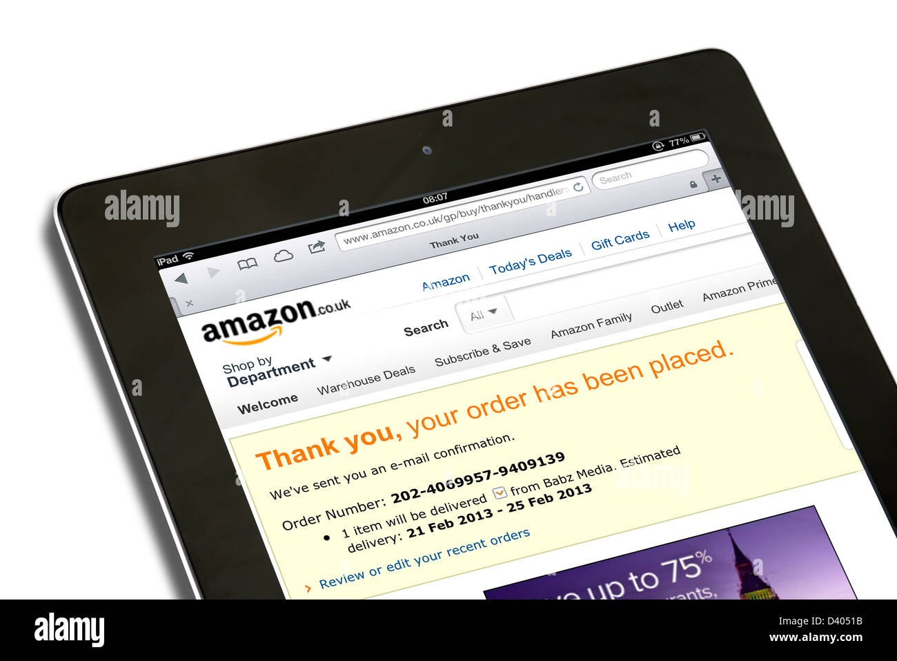 Order confirmation for online shopping on the amazon.co.uk website viewed on a 4th generation Apple iPad tablet - Stock Image
