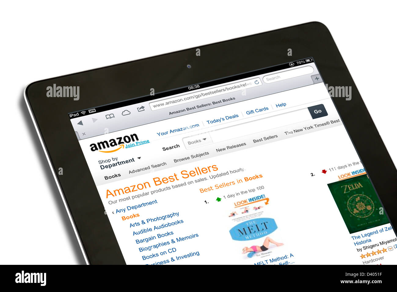 Shopping for books on the amazon.com USA website on a 4th generation Apple iPad tablet computer - Stock Image