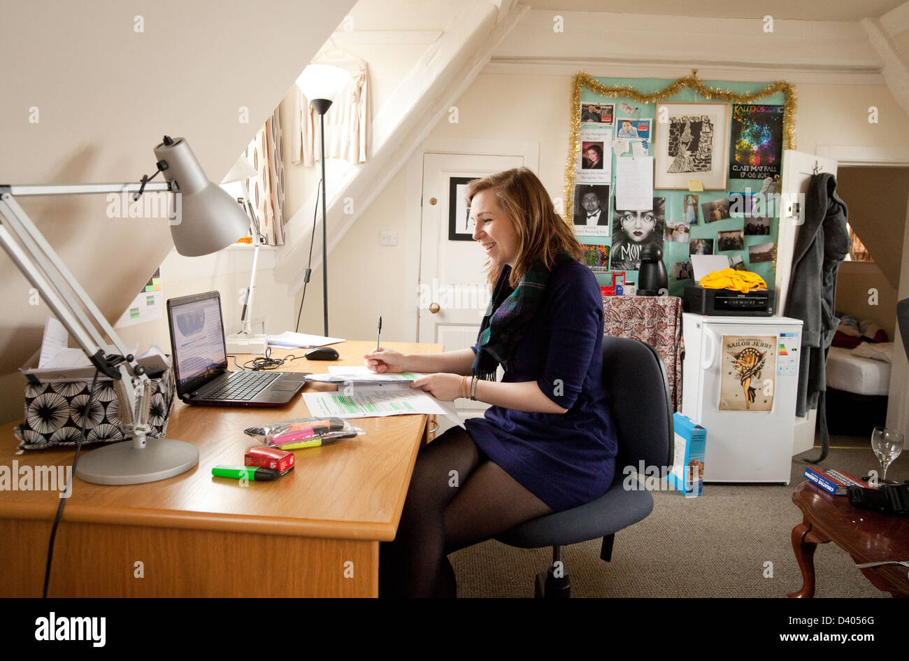 A Cambridge University student studying on her College room, Clare College, Cambridge UK - Stock Image