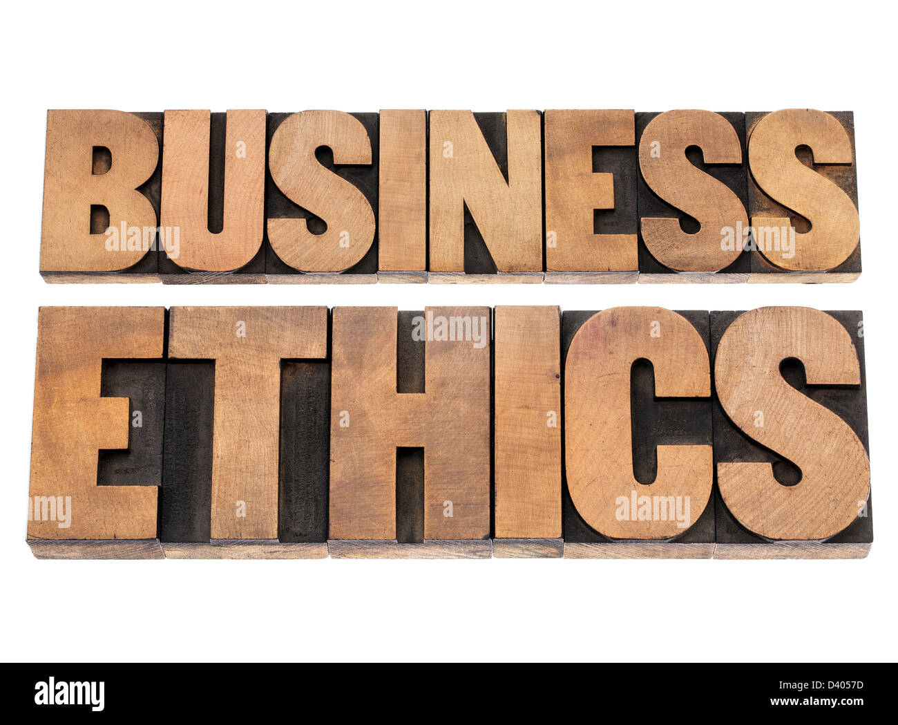 business ethics - isolated text in letterpress wood type printing blocks - Stock Image