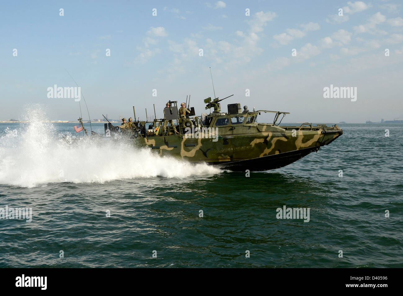 US Navy SEALS conduct patrol operations February 23, 2013 in the port of Bahrain. - Stock Image