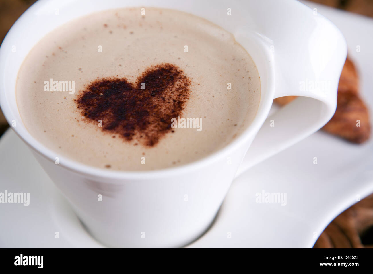 dd9ec93aa88 A fancy coffee latte with a love heart on top in a clean bright white cup