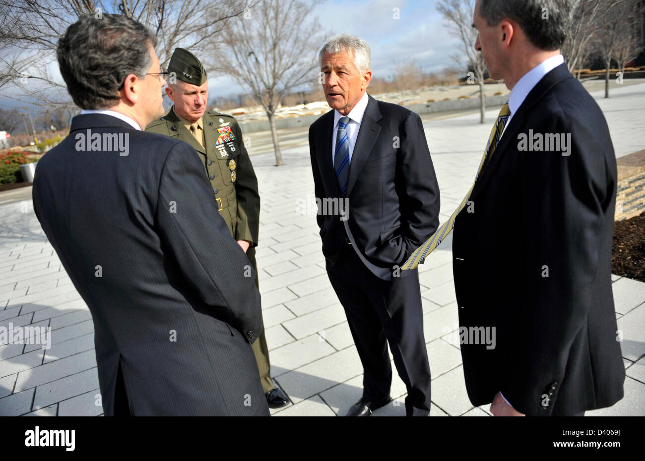 US Secretary of Defense Chuck Hagel is given a tour of the 9-11 Memorial by Michael Rhodes (left) the Pentagon's - Stock Image
