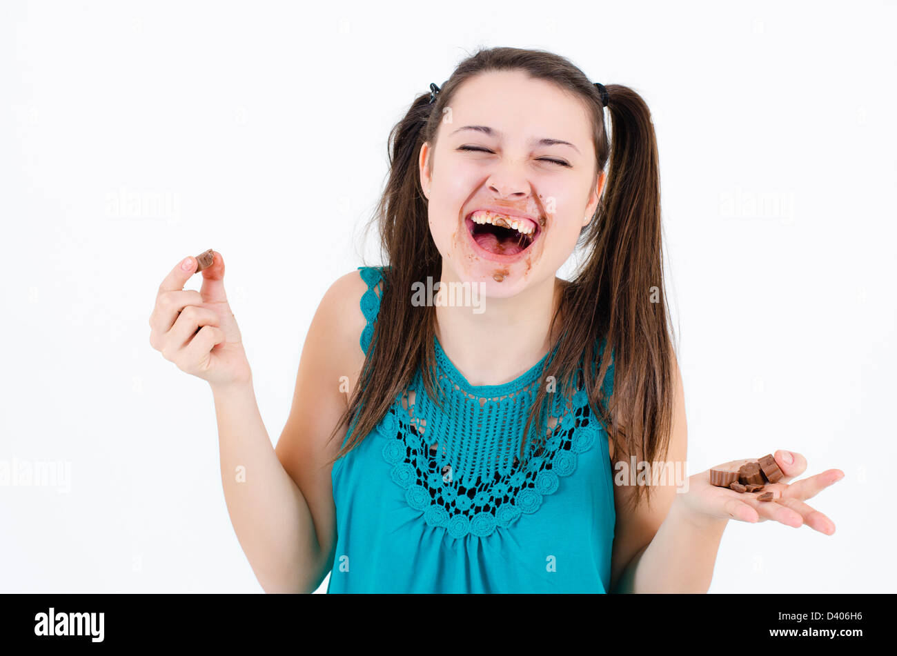 A insatiable girl girl holding a piece of chocolate - Stock Image