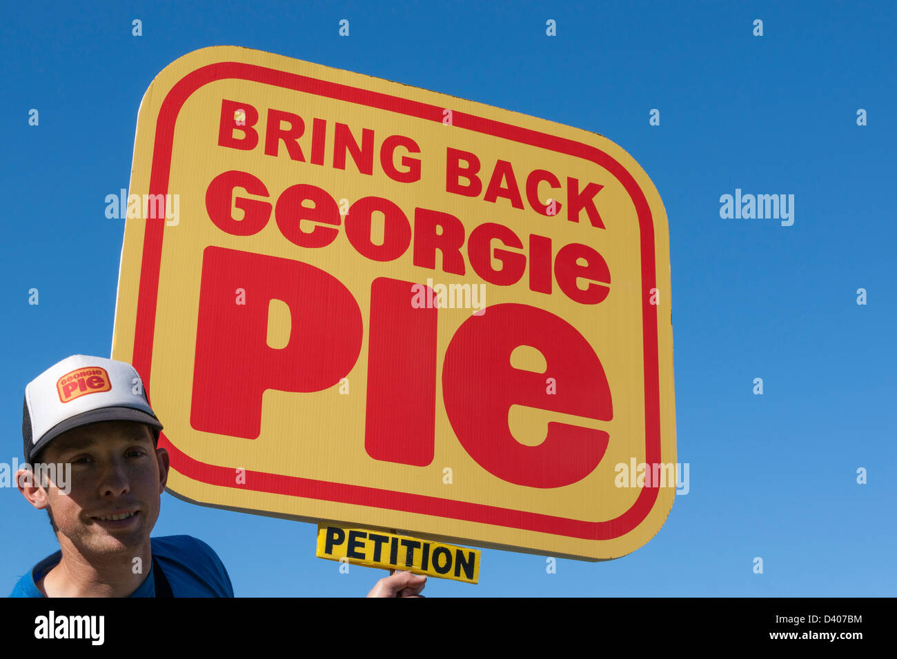 Campaigning, young man seeking signatures for a petition. - Stock Image