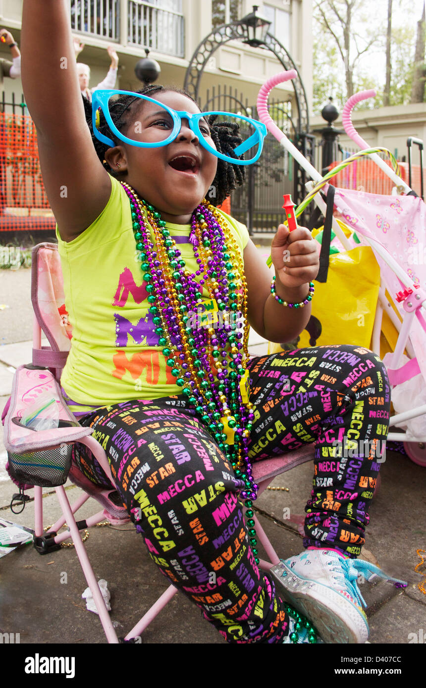 Young girl shouting for beads on Mardi Gras day, New Orleans. Stock Photo