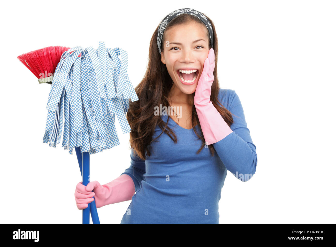 Portrait of happy and surprised house cleaning woman with mops isolated on white background - Stock Image