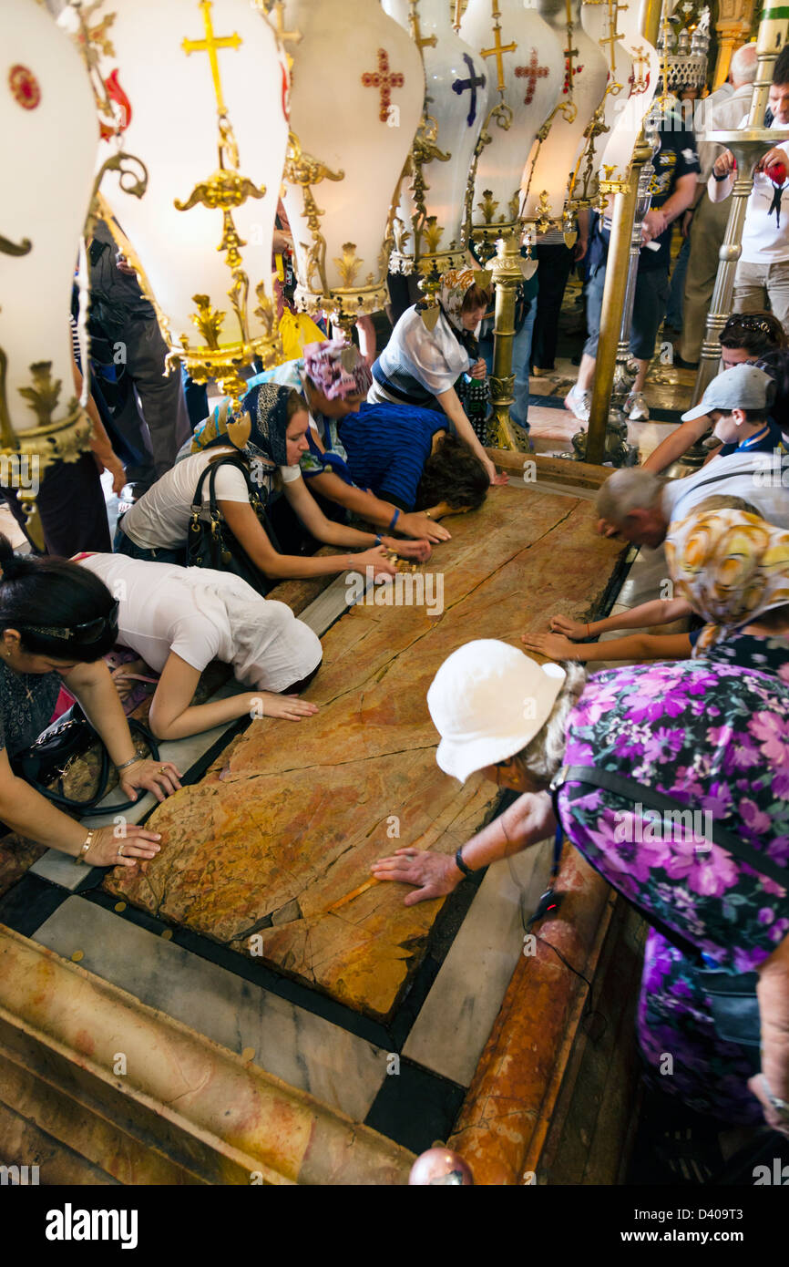 Stone of Anointing in the Church of Holy Sepulchre, Jerusalem - Stock Image