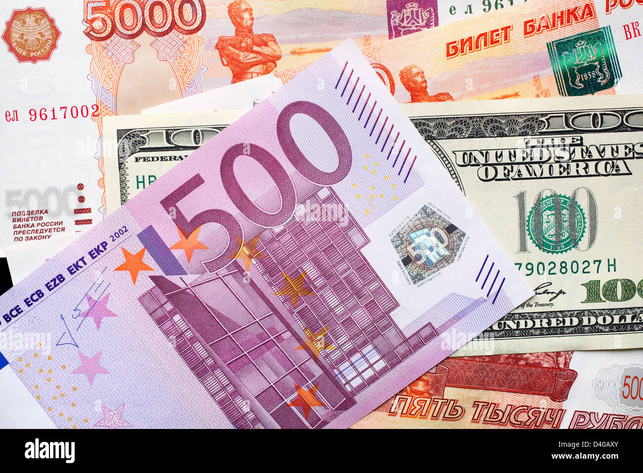 500 Euro banknote, 100 Dollars banknote and 5000 Russian Rubles banknotes in background Stock Photo