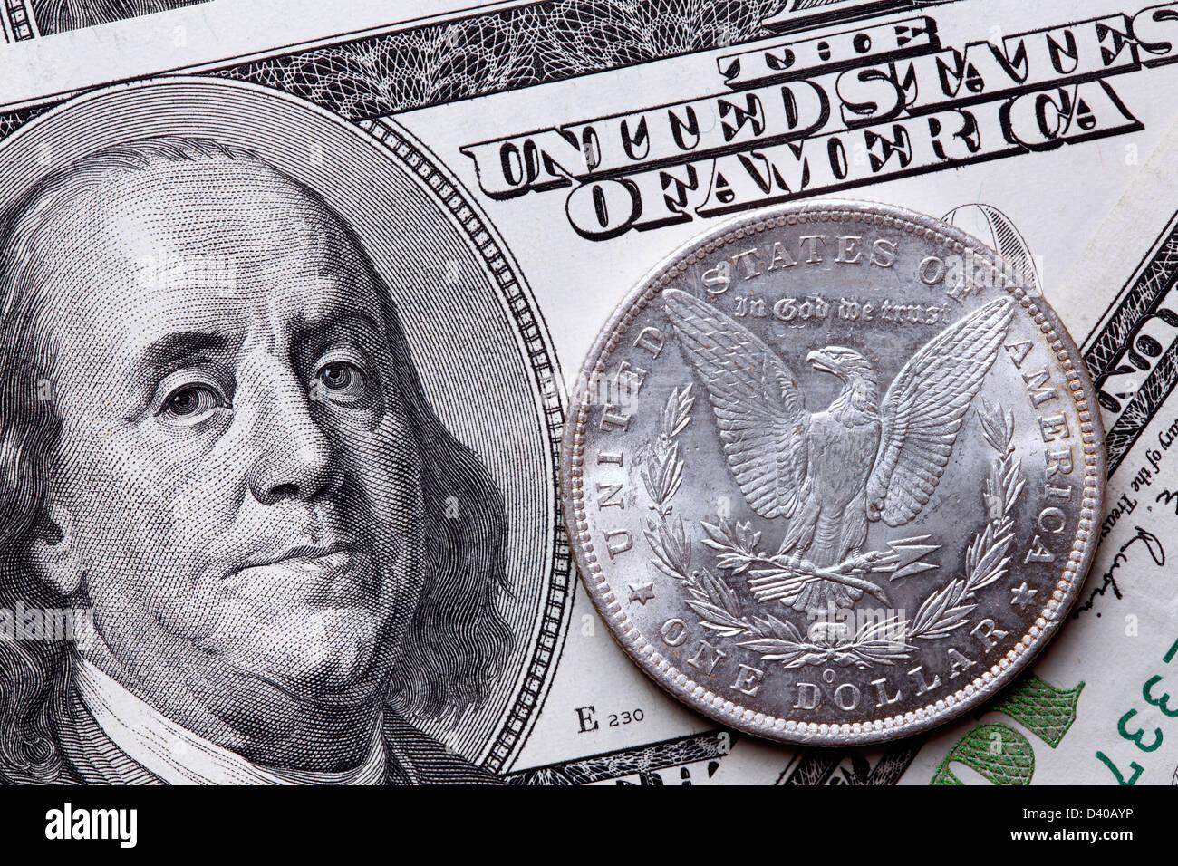 100 Dollars banknote, Benjamin Franklin, USA (2006) and silver Morgan Dollar coin, USA (1885) - Stock Image