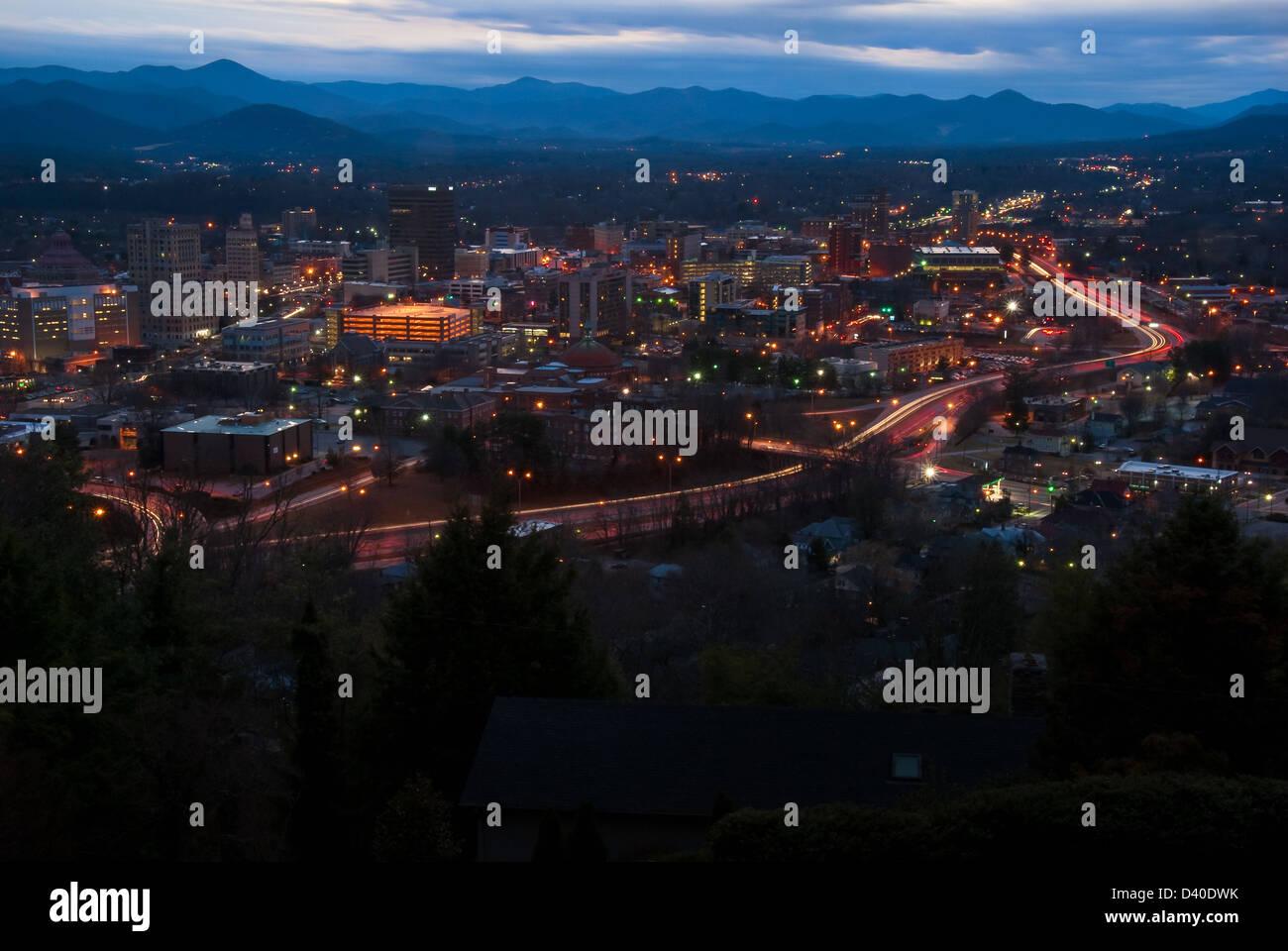 Asheville, North Carolina cityscape and mountain skyline at late dusk. - Stock Image