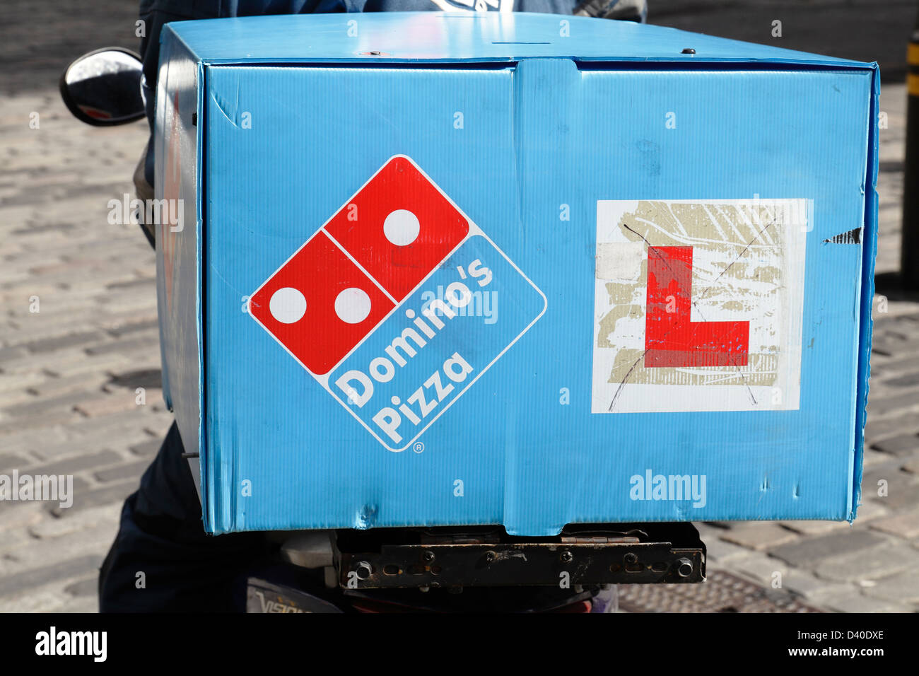 A Domino's Pizza delivery on a scooter in Scotland, UK - Stock Image