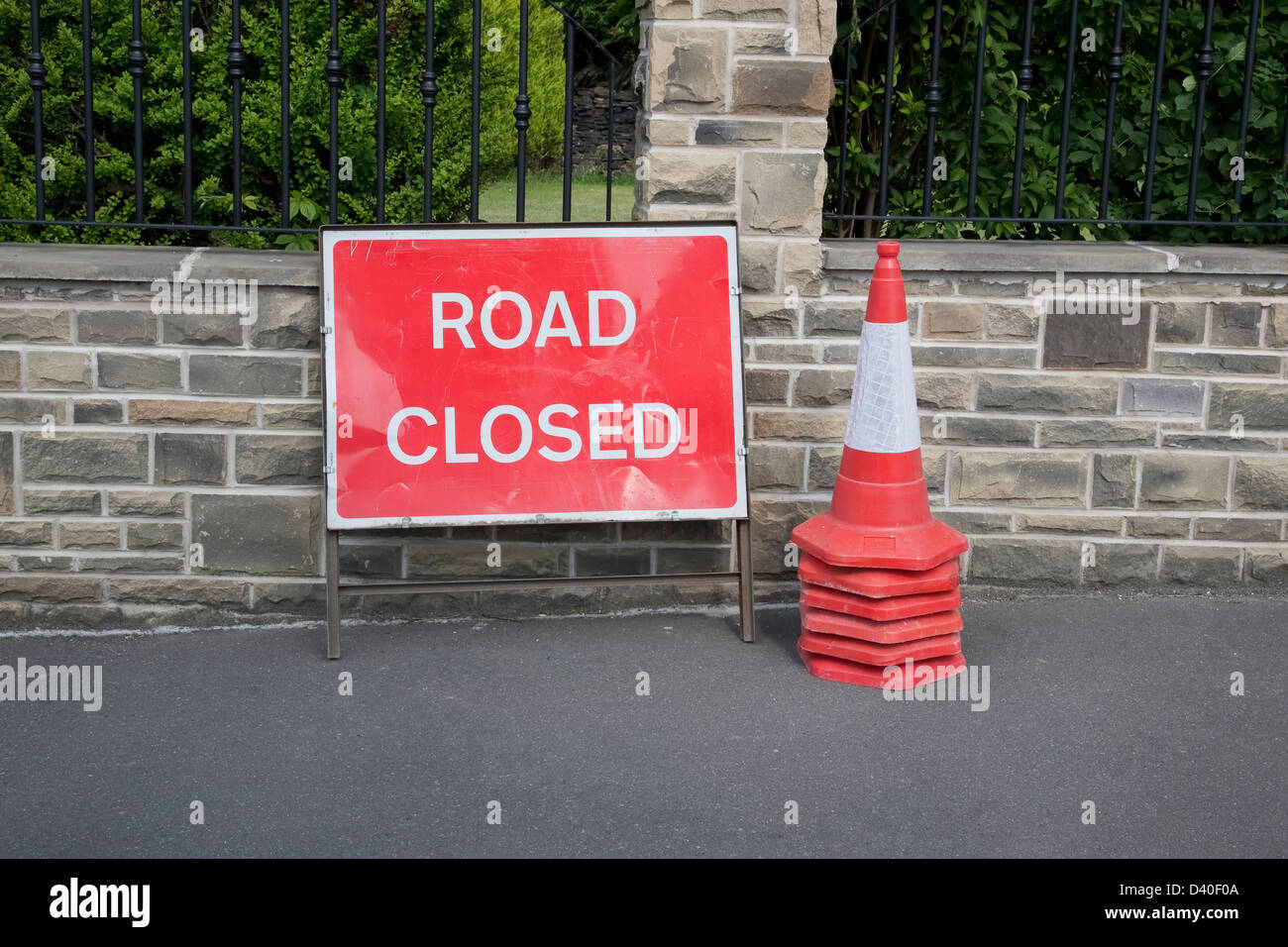 Road Closed sign and traffic cones in the UK - Stock Image