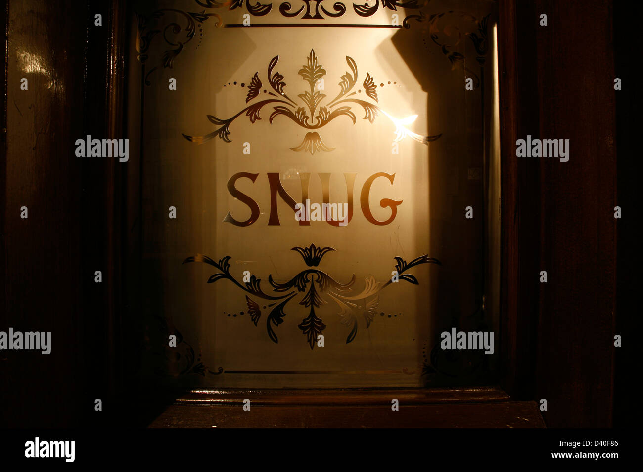 Etched glass window to the snug of the John Snow pub on Broadwick Street, Soho, London, UK - Stock Image