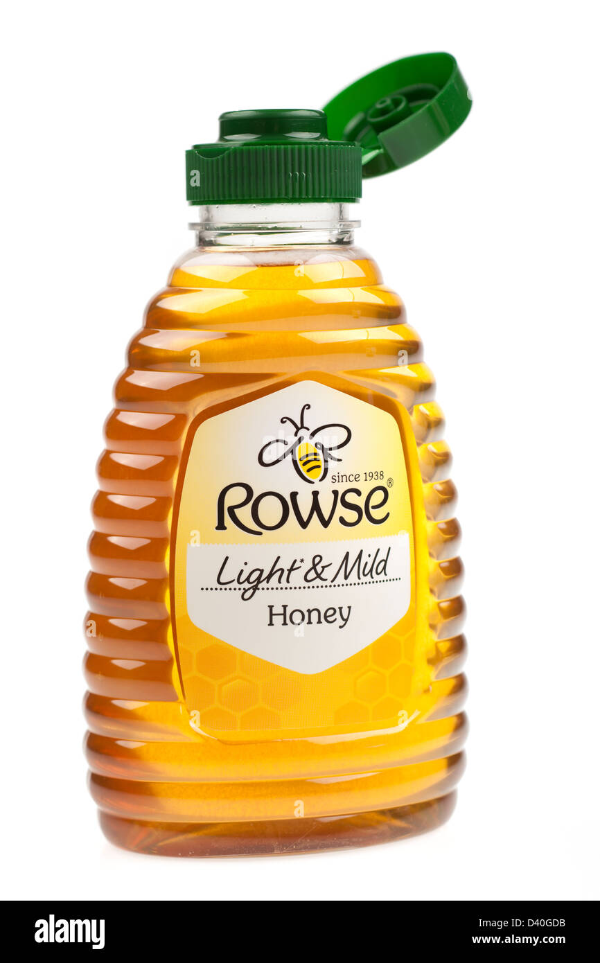 Open plastic container of Rowse light and mild honey - Stock Image