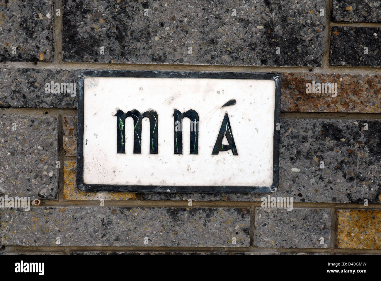 Mna is for Women's toilet or washroom in Gaelic, seen in Ireland - Stock Image