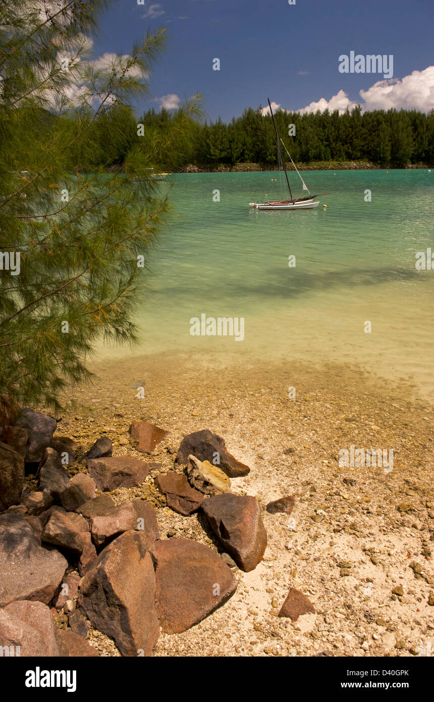 Boats and yachts in a natural harbour on Praslin in the Seychelles - Stock Image