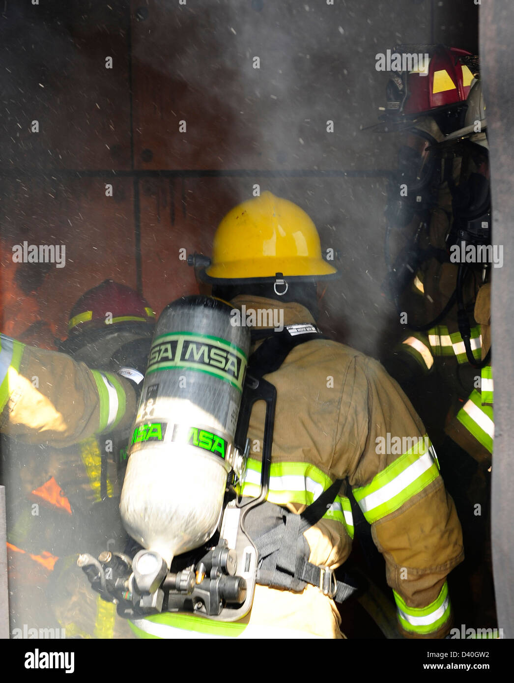 Firefighters from the 612th Air Base Squadron, Honduras and Belize train on extinguishing structural fires during Stock Photo