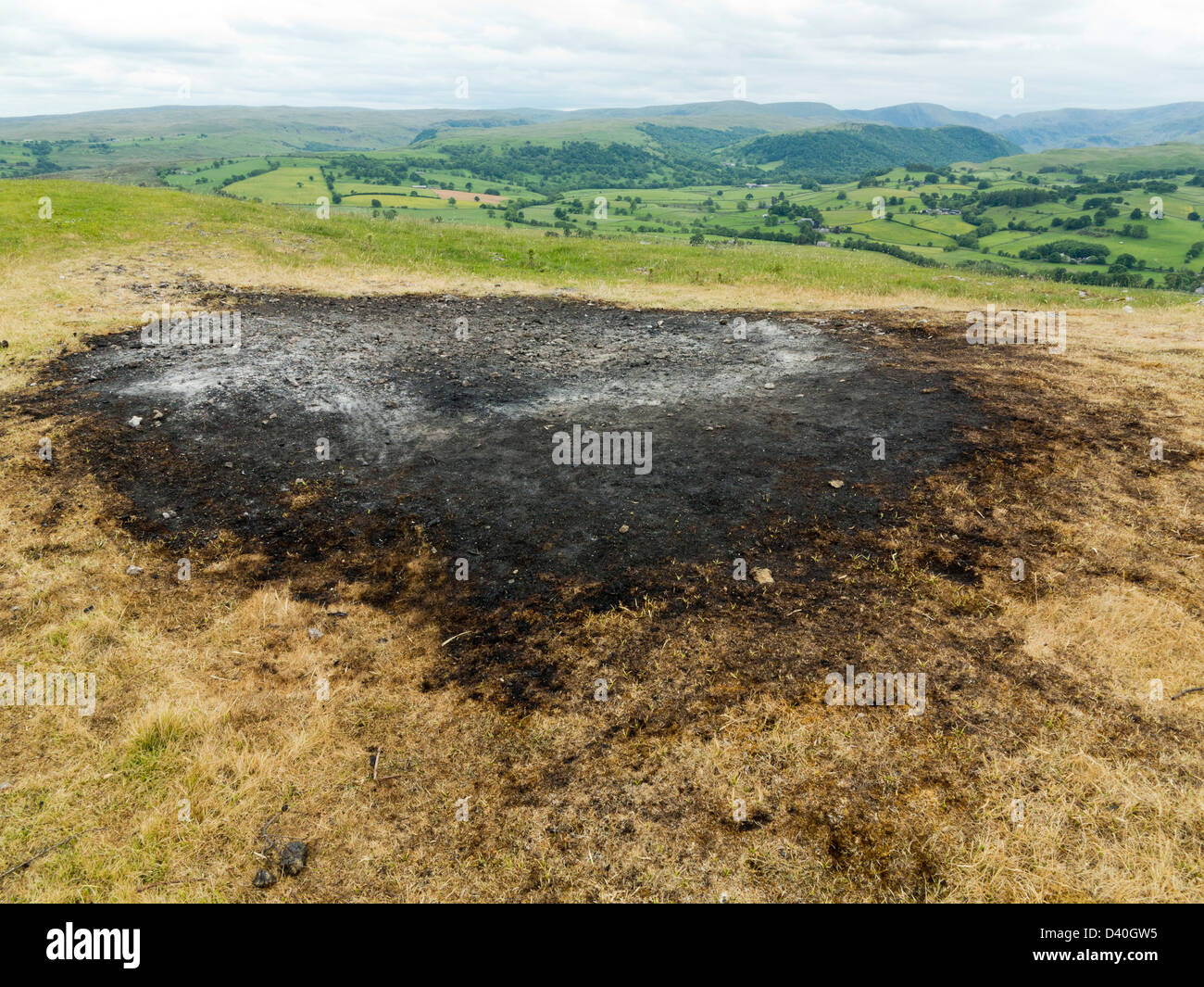 Scorch mark left by Jubilee Bonfire on top of Knipe Scar, Bampton Cumbria Lake District England - Stock Image