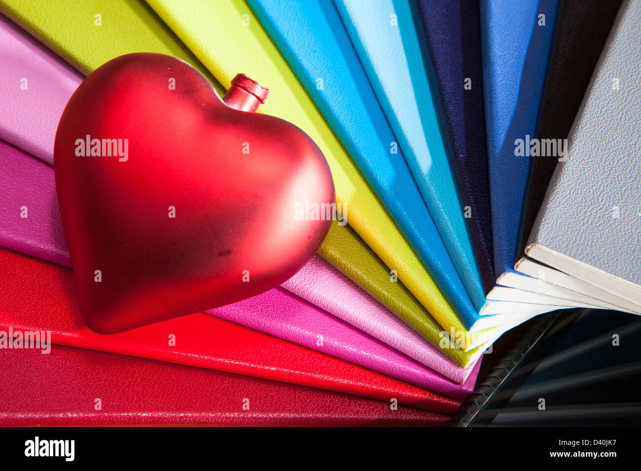 Twelve diaries and red heart - Stock Image
