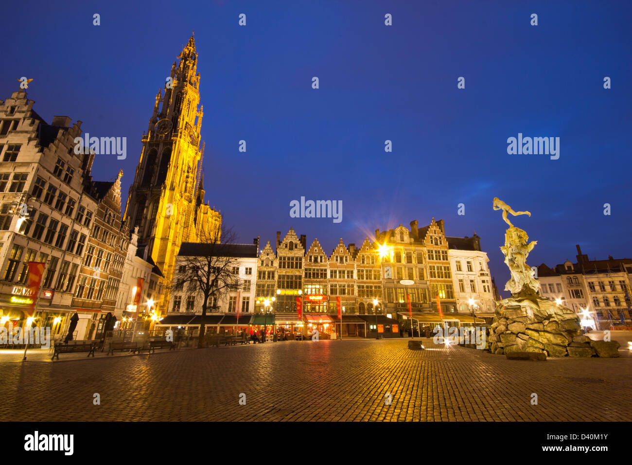 Antwerp by night with the Cathedral of Our Lady and the statue from the Grote markt. - Stock Image