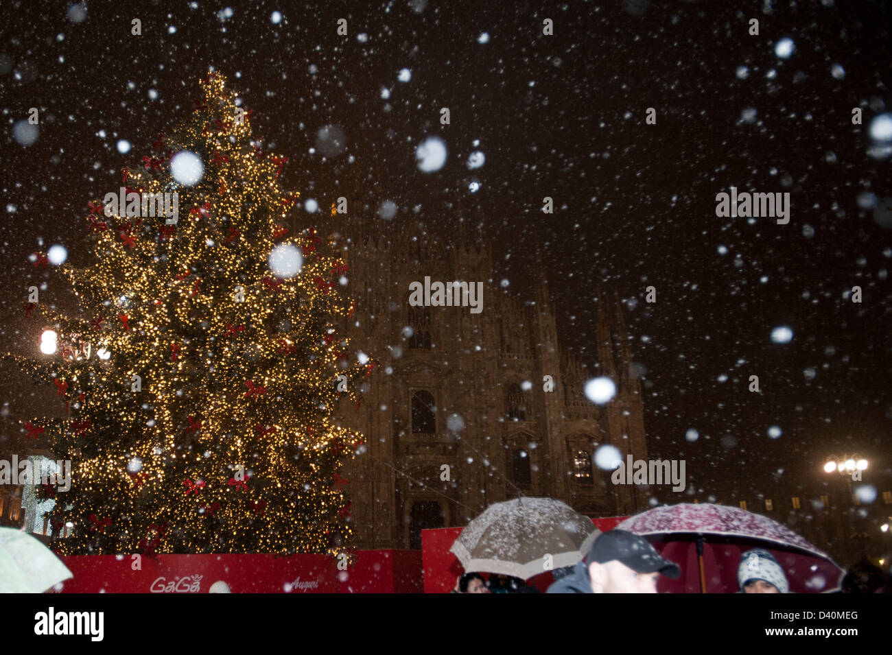 Stage chrismas tree and Duomo church with snow during Christmas at  town square at Milano, Italy Stock Photo
