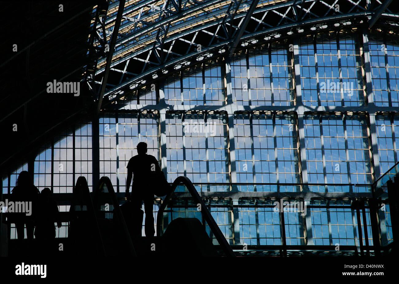 Barlow Shed roof at St Pancras International Eurostar train station kings cross London.silhouette  figures emerging - Stock Image