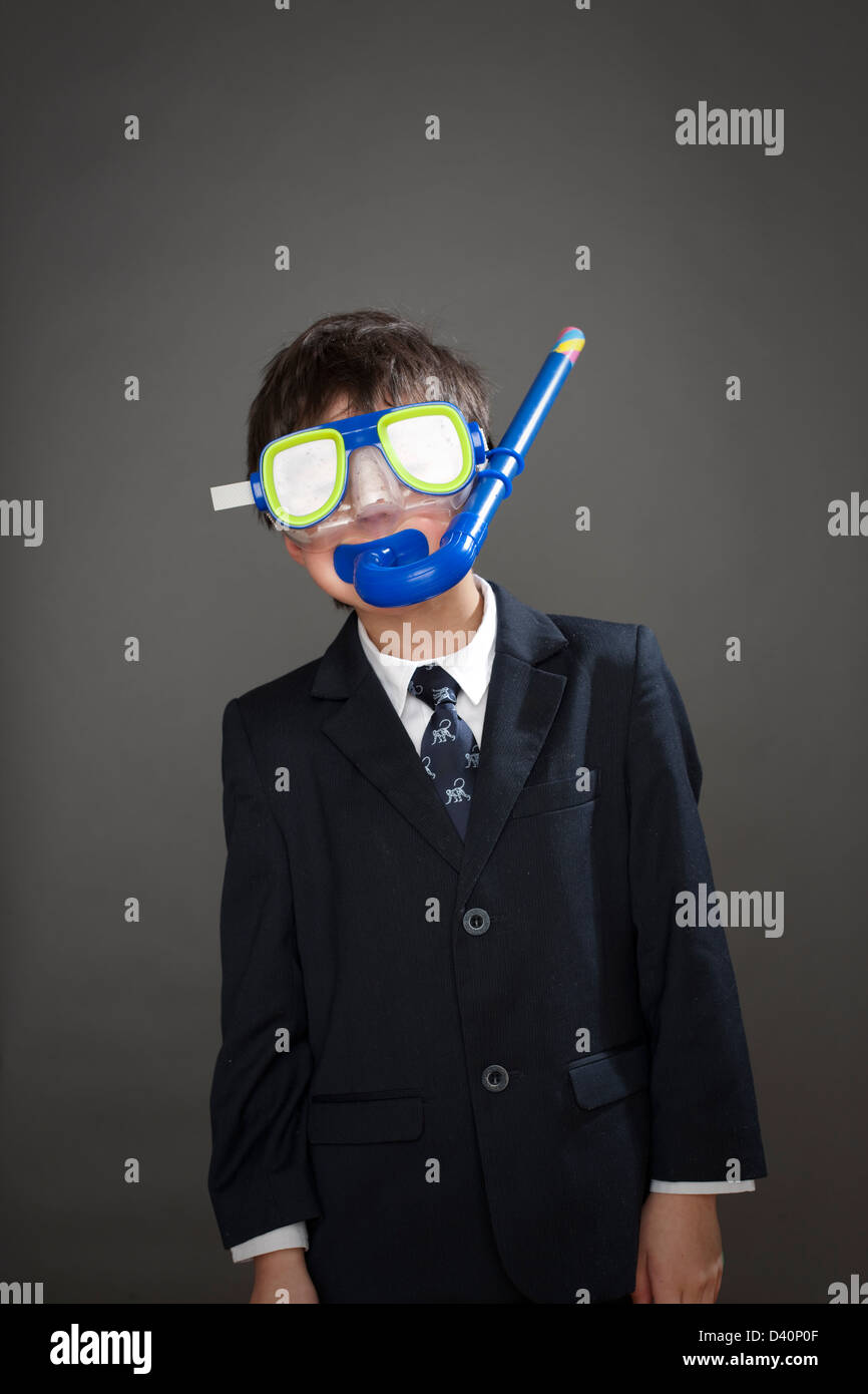 Boy wearing suit jacket and snorkel mask - Stock Image