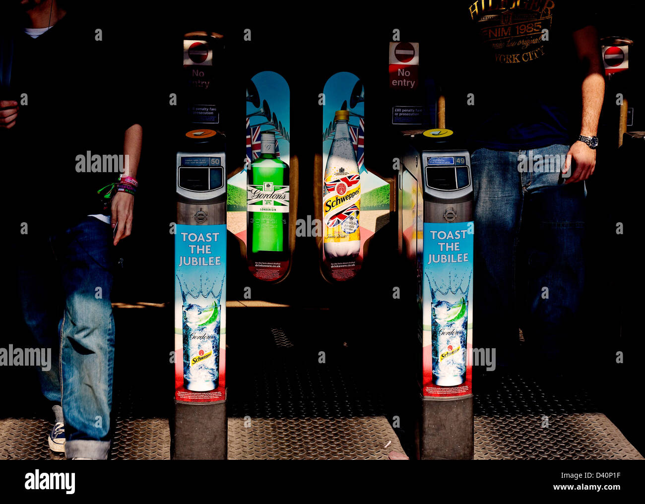 Tube station exit Camden town Toast the jubilee adverts on ticket barrier - Stock Image