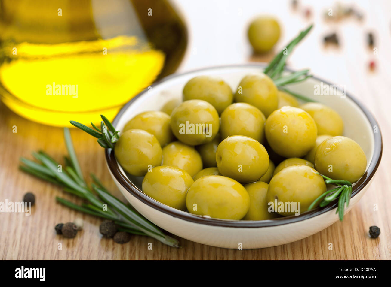 green olives and oil - Stock Image