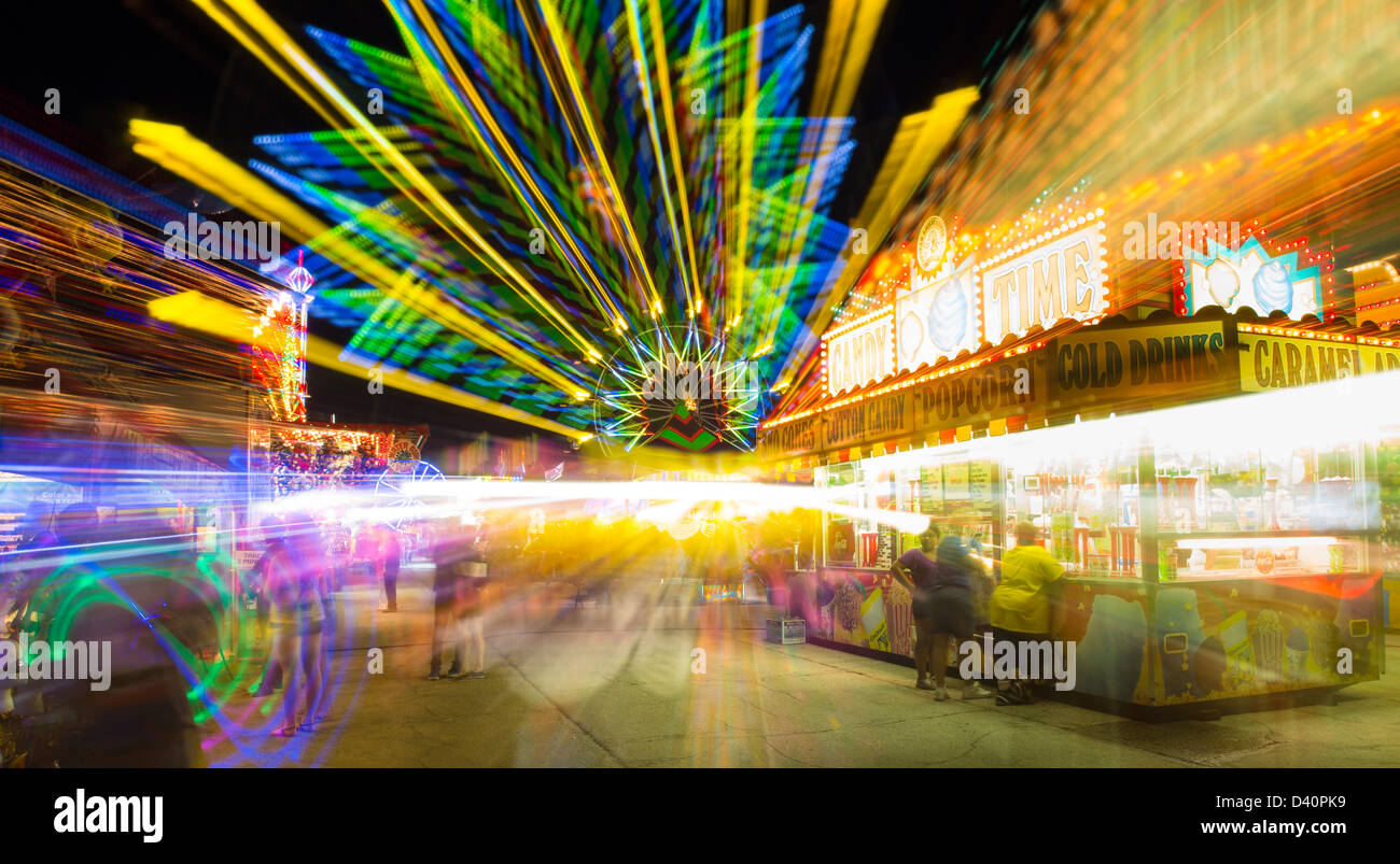 Carnival rides at night showing blurred motion at Italian Feast in Venice Florida - Stock Image