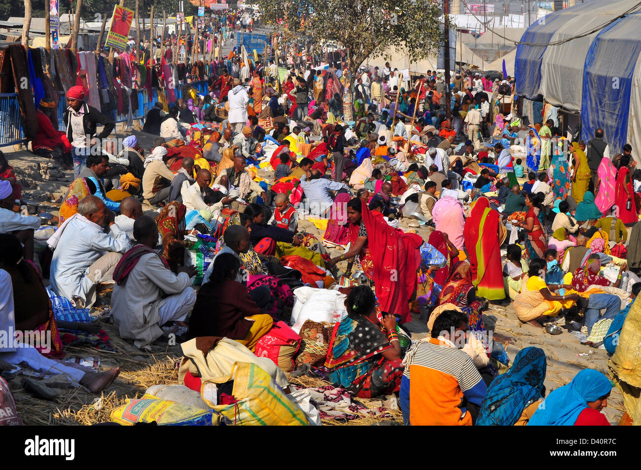 Hindu devotees camp on the banks of Sangam confluence of river Ganga, Yamnuna and mythical Saraswati during Kumbh - Stock Image