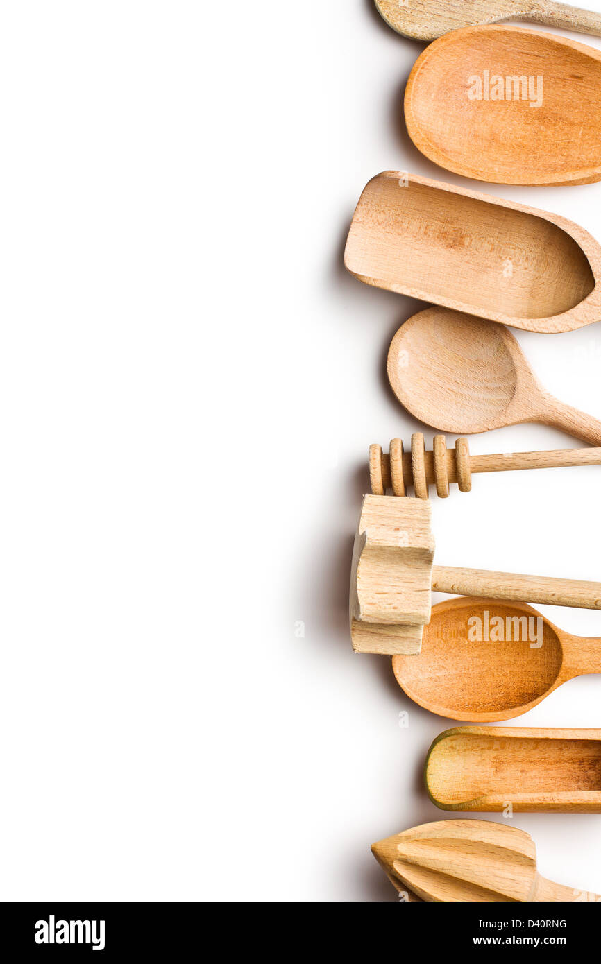 border of wooden kitchen utensils on white background Stock Photo