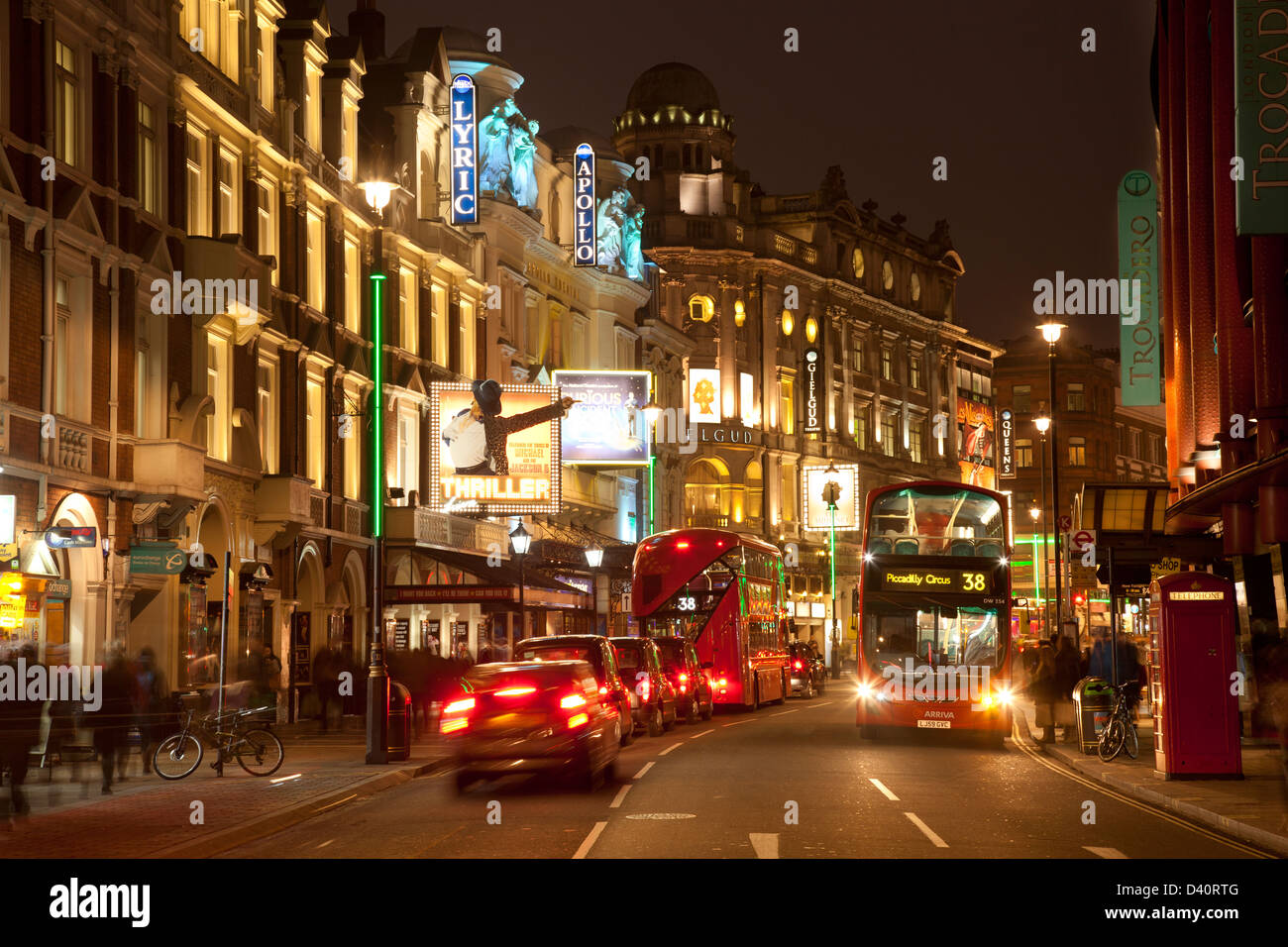 Heart of London theatreland, Shaftesbury Avenue: Lyric, Apollo, Gielgud, Queens theatres with 2 buses, inc new Routemaster - Stock Image