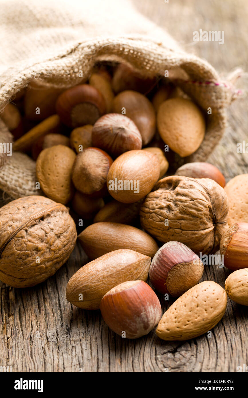 the various nuts in jute sack - Stock Image