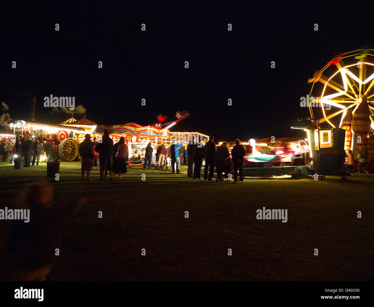 The old time Steam fair at Lincolnshire steam and vintage rally seen at night - Stock Image