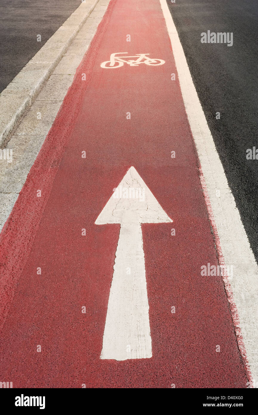 Cycle path with white cycle symbol and one way direction arrow, UK - Stock Image