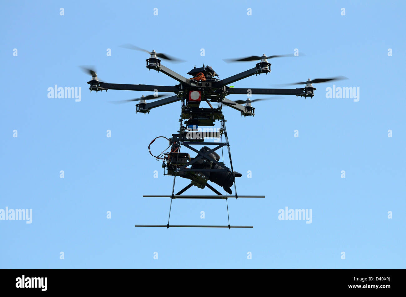 Drone in flight and Digital camera on a flying Unmanned Aerial Vehicle (UAV), with six rotors, used aerial photography - Stock Image