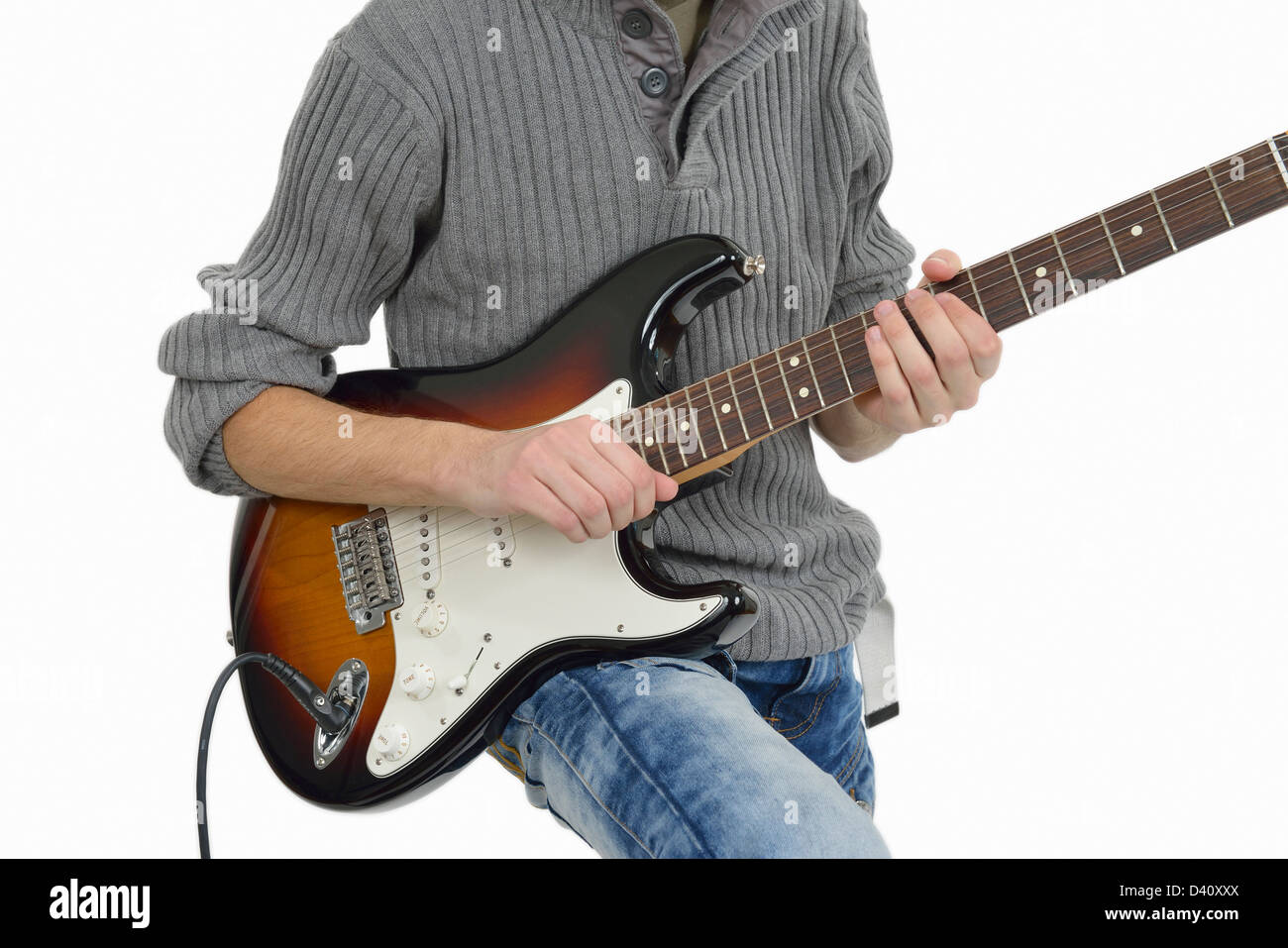 Teenager playing electric guitar - Stock Image
