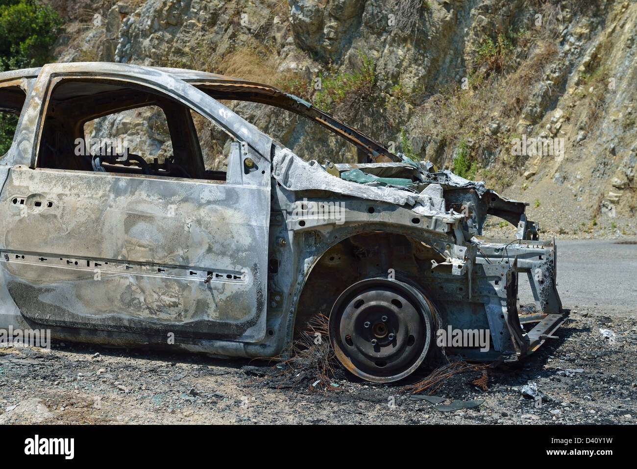 Abandoned burnt out vehicle wreck - Stock Image