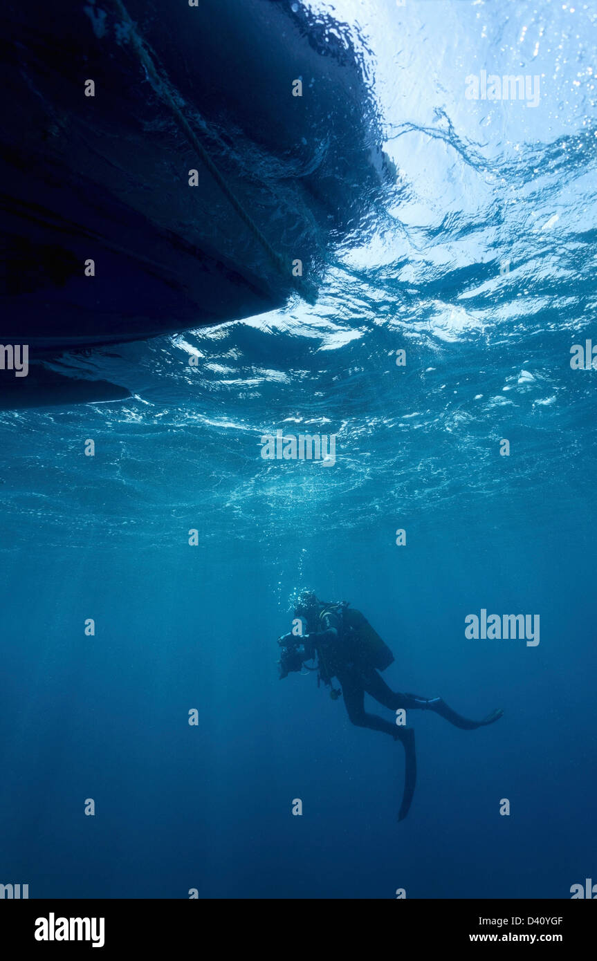 Diver by a boat - Stock Image